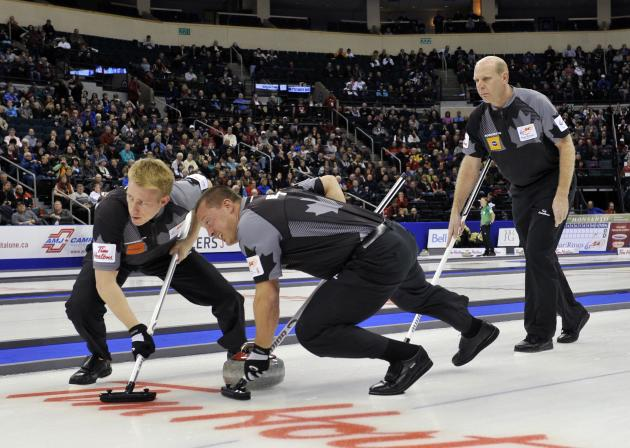 Skip Kevin Martin follows his sweepers second Marc Kennedy and lead Ben Hebert during the game against Team Epping at the Roar of the Rings Canadian Olympic Curling Trials in Winnipeg