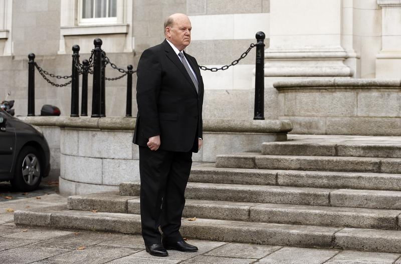 Irish government, eye on re-election, reverses cuts in budget