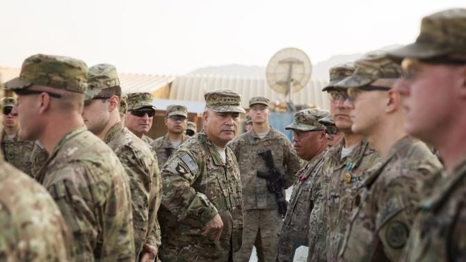 General John Francis Campbell, current commander of the International Security Assistance Force and United States Forces in Afghanistan, speaks to soldiers during a Christmas day visit on forward operating base Gamberi in the Laghman province of Afghan