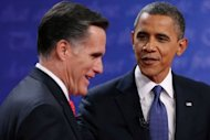 US President Barack Obama (R) and Republican presidential candidate Mitt Romney speak after the Presidential Debate at the University of Denver on October 3, 2012 in Denver, Colorado. The debate on the economy, health care and the role of government, was the first of four ahead of the 2012 Election