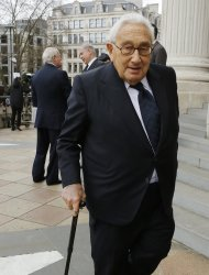 Former U.S. secretary of state Henry Kissinger leaves after attending the funeral service of former British Prime Minister Margaret Thatcher at St Paul's Cathedral, in London April 17, 2013. Thatcher, who was Conservative prime minister between 1979 and 1990, died on April 8 at the age of 87. (AP Photo/Olivia Harris, pool)