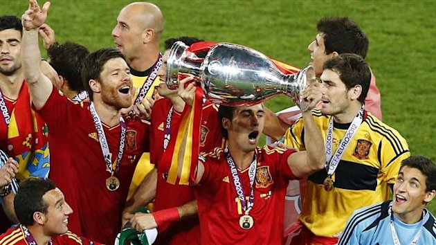 Spain celebrate with the Euro 2012 trophy