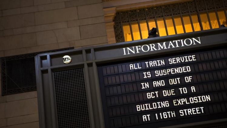 A sign warns of delays at Grand Central Station after an apparent building explosion fire and collapse in the Harlem section of New York