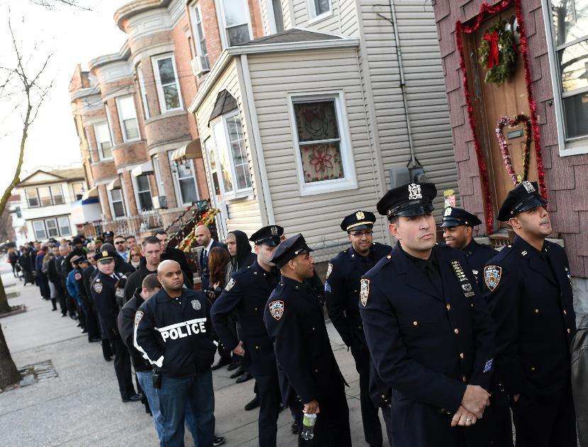 Prayer vigil held in New York for slain police officer