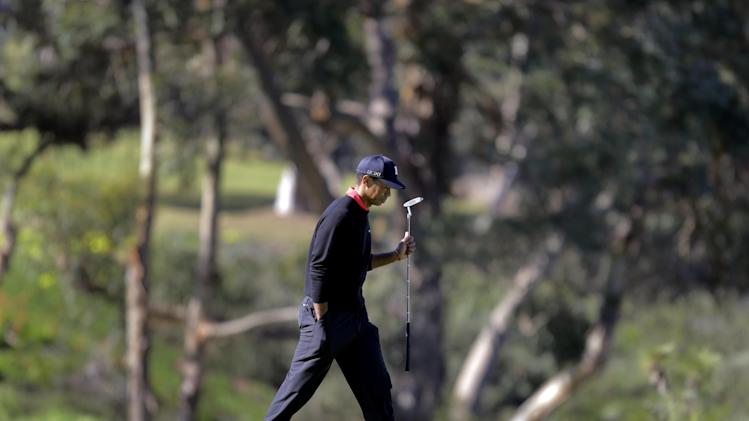 Tiger Woods takes a look at the green before putting on the 13th hole during the fourth round of the Farmers Insurance Open golf tournament at the Torrey Pines Golf Course, Monday, Jan. 28, 2013, in San Diego. (AP Photo/Lenny Ignelzi)