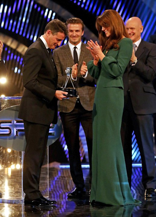 Kate, the Duchess of Cambridge applauds after presenting Lord Sebastian Coe with the Lifetime Achievement Award during the BBC Sports Personality of the Year Awards 2012 in London, Sunday Dec. 16, 201
