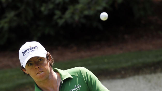 Rory McIlroy, of Northern Ireland, chips to the 13th green during a practice round for the Masters golf tournament Wednesday, April 4, 2012, in Augusta, Ga. (AP Photo/Chris O'Meara)