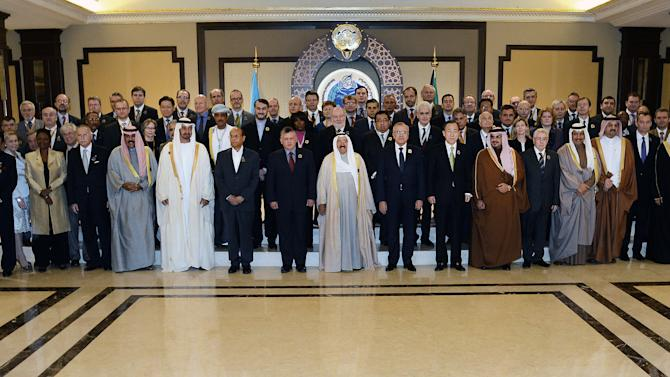 "Representatives from member states, UN agencies, and non-governmental organizations pose for a group photo at Bayan Palace in Kuwait City, Wednesday, Jan. 30, 2013. The U.N. chief made a dramatic appeal Wednesday for a major boost in relief aid for Syria, calling for an end to the fighting ""in the name of humanity"" as an international conference opened in Kuwait with both foes and backers of President Bashar Assad. (AP Photo/Gustavo Ferrari)"