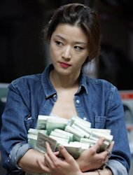 "South Korean actress Jun Ji-hyun starring as a thief in Choi Dong-hun's 2012 heist thriller ""The Thieves"", filmed in Macau. For the people behind the film, the bright lights and massive casino resorts of Macau offered an extra touch of realism"