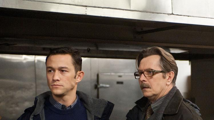 "This undated film image released by Warner Bros. Pictures shows Joseph Gordon-Levitt as John Blake, left, and Gary Oldman as Commissioner Gordon  in a scene from the action thriller ""The Dark Knight Rises."" (AP Photo/Warner Bros. Pictures, Ron Phillips)"
