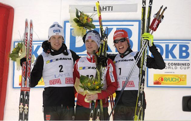 Second placed Tino Edelmann of Germany (L), winner Jan Schmid of Norway (C) and thrid placed Johannes Rydzek of Germany celebrates after the men's Nordic Combined Gundersen 10km World Cup race at the