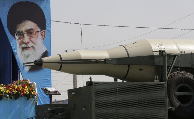 A Sajjil missile is displayed by Iran&#39;s Revolutionary Guard, in front of a portrait of the Iranian supreme leader Ayatollah Ali Khamenei, during a military parade commemorating the start of the Iraq-Iran war 32 years ago, in front of the mausoleum of the late revolutionary leader Ayatollah Khomeini, just outside Tehran, Iran, Friday, Sept. 21, 2012. (AP Photo/Vahid Salemi)