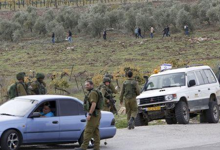 Palestinian stabs Israeli soldier and is shot dead: army