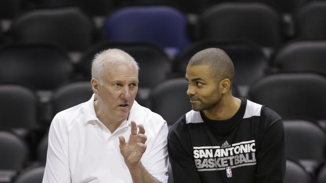 San Antonio Spurs head coach Gregg Popovich, left, and guard Tony Parker, right, of France, talks during a practice, Wednesday, June 12, 2013, in San Antonio. San Antonio will face the Miami Heat in game 4 of the NBA Finals basketball game Thursday. San Antonio leads the best-of-seven series 2-1. (AP Photo/Eric Gay)