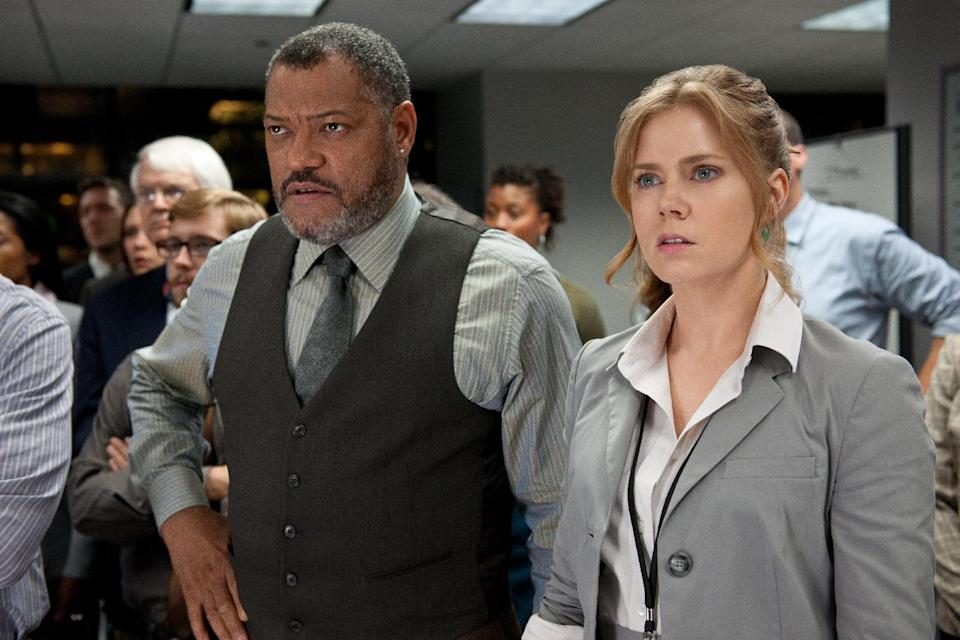 "This film publicity image released by Warner Bros. Pictures shows Laurence Fishburne as Perry White, left, and Amy Adams as Lois Lane in ""Man of Steel."" (AP Photo/Warner Bros. Pictures, Clay Enos)"