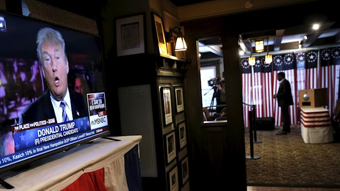 U.S. Republican presidential candidate Donald Trump is seen on a television screen before voting begins for the U.S. presidential primary election inside Hale House at the Balsams Hotel in Dixville Notch