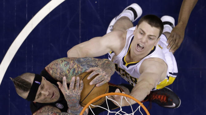 Miami Heat's Chris Andersen, left, grabs a rebound from Indiana Pacers' Tyler Hansbrough during the second half of Game 3 of the NBA Eastern Conference basketball finals in Indianapolis, Sunday, May 26, 2013. (AP Photo/Michael Conroy)