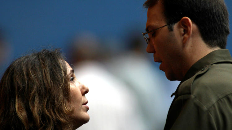 In this photo taken June 19, 2007, Mariela Castro speaks with her brother Alejandro Castro, before a private gathering in honor of their late mother, and wife of Cuba's acting President Raul Castro, Vilma Espin Guillois, at Karl Marx Theater in Havana, Cuba. On the eve of her controversial arrival in the United States to attend a conference on Latin America Thursday, May 24, 2012, prominent academics say the 49-year-old Cuban first daughter has carved out an important name for herself that goes beyond her family lineage or famous last name, making gay rights her life's cause. (AP Photo/Ismael Francisco, Prensa Latina)