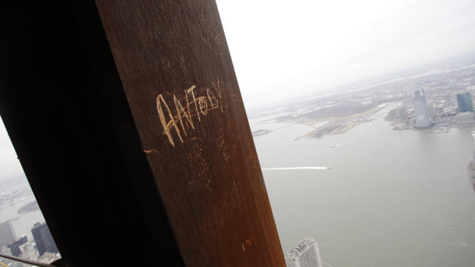 "In this Jan. 15, 2013 photo, ""Antony,"" left his graffiti on a steel column on the 102nd floor of One World Trade Center in New York. Workers finishing New York's tallest building at the World Trade Center are leaving their personal marks on the concrete and steel in the form of graffiti. (AP Photo/Mark Lennihan)"