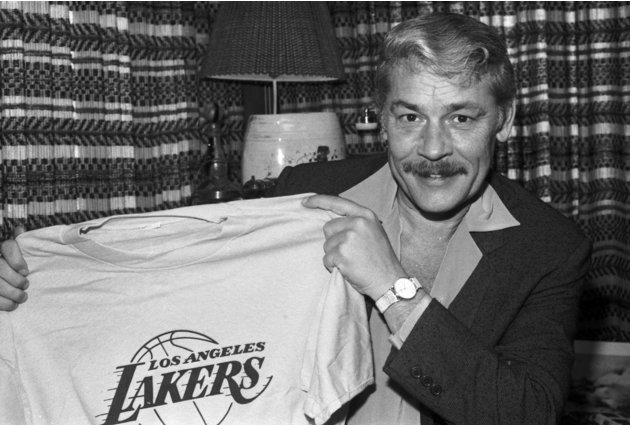FILE - In this June 18, 1981 file photo, Jerry Buss holds a Los Angeles Lakers shirt in Los Angeles. Buss died Monday, Feb. 18, 2013. Buss, the Lakers' playboy owner who shepherded the NBA franchise t