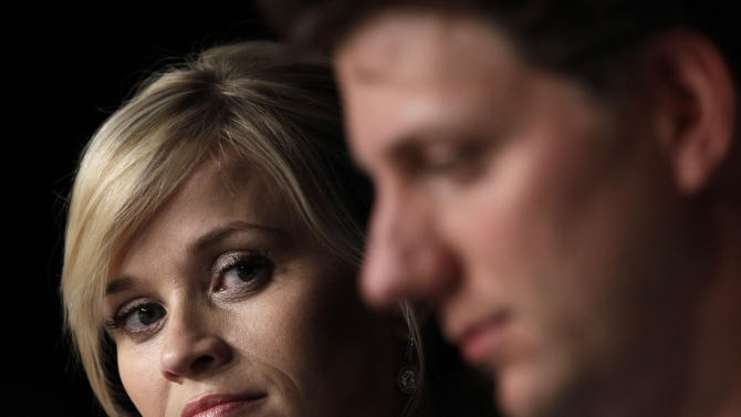 Actress Reese Witherspoon, left, and director Jeff Nichols listen during a press conference for Mud at the 65th international film festival, in Cannes, southern France, Saturday, May 26, 2012. (AP Photo/Lionel Cironneau)