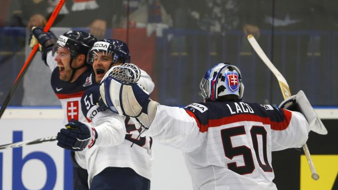 Slovakia's Meszaros celebrates his goal against Belarus with team mates Granak and goaltender Laco during their Ice Hockey World Championship game at the CEZ arena in Ostrava