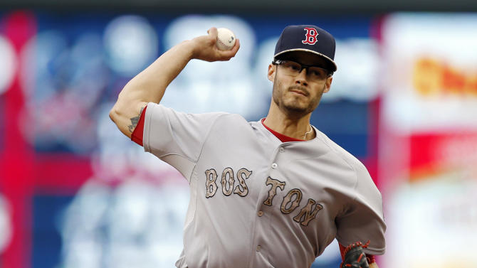 Boston Red Sox pitcher Joe Kelly throws against the Minnesota Twins in the first inning of a baseball game, Monday, May 25, 2015, in Minneapolis. (AP Photo/Jim Mone)