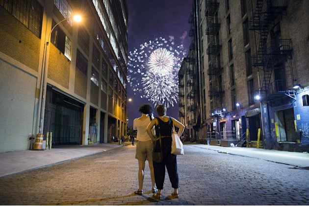 Spectators watch as fireworks light up the sky over the Hudson River during the Macy's Fourth of July fireworks show Wednesday, July 4, 2012, in New York. (AP Photo/John Minchillo)