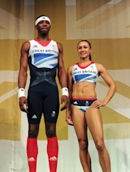 "Triple jumper Phillips Idowu and heptathlete Jessica Ennis model the Team GB kit designed by Stella McCartney. The Stella McCartney-designed vests for the British team received the ""gold medal for riskiness"" from L'Officiel, a French fashion magazine, for their variation on the Union Jack"