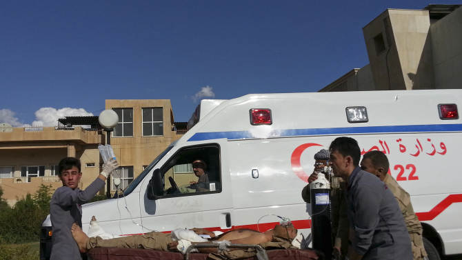 A Kurdish Peshmerga soldier who was wounded in fierce battles in nearby Nineveh province with Islamic State group militants is brought to the Zakho Emergency Hospital for treatment, in Dahuk, 260 miles (420 kilometers) northwest of Baghdad Tuesday, Sept. 30, 2014. (AP Photo/ Hadi Mizban)