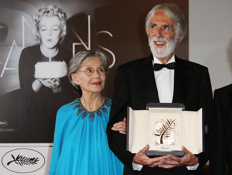 Michael Haneke, right, poses for photographers with the Palme d'Or award for Love alongside Emmanuelle Riva during a photo call at the 65th international film festival, in Cannes, southern France, Sunday, May 27, 2012. (AP Photo/Joel Ryan)