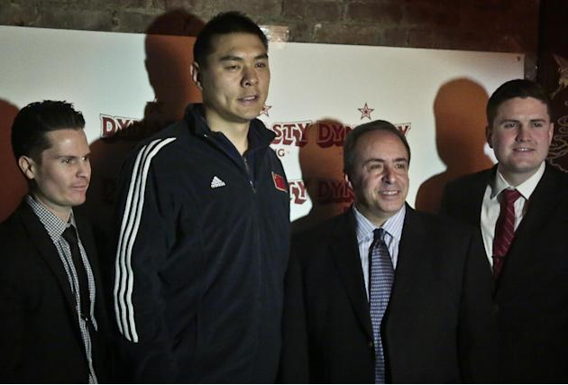 Chinese Boxer Zhang Zhilei, second from left,  a 2008 Beijing Olympics silver medalist, pose with boxing promoters Dino Duva, second from right, and brothers Terry Lane, far right, and Tommy Lane, far