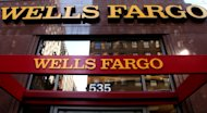 <p>               In this May 6, 2012, photo, a Wells Fargo sign is displayed at a branch in New York. Wells Fargo is reporting higher earnings for the second quarter thanks to a pickup in lending and a decline in the amount of bad loans, according to reports Friday, July 13, 2012. (AP Photo/CX Matiash)