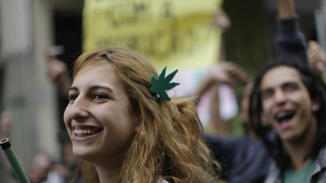 A demonstrator wearing a hair decoration in the shape of a cannabis leaf attends a march in favor of the legalization of marijuana in Sao Paulo, Brazil, Saturday July 2, 2011. The Brazilian Supreme Court ruled on June 15, 2011 that demonstrations favoring the legalization of cannabis are an exercise of free expression and do not encourage people to consume it. (AP Photo/Nelson Antoine)