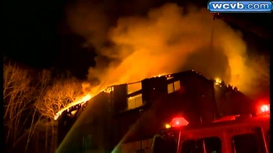 Fire at condo complex claims couple, injures grandson
