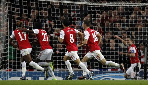 Arsenal players celebrate with van Persie after scoring a goal against Borussia Dortmund during their Champions League soccer match in London