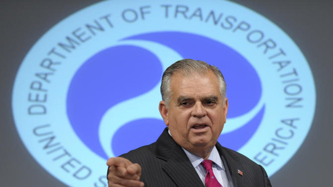 Transportation Secretary Raymond LaHood gestures during a news conference at the Transportation Department in Washington, Thursday, Aug. 2, 2012, to strongly disputed media reports characterizing the incident as a near-miss at Ronald Reagan Washington National Airport Tuesday.  (AP Photo/Susan Walsh)