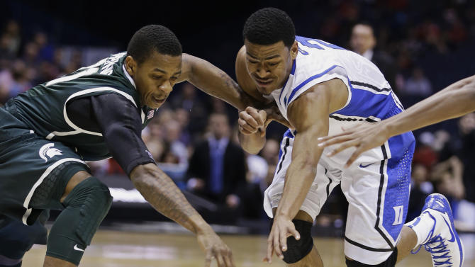 Michigan State guard Keith Appling, left, and Duke guard Quinn Cook battle for a loose ball during the first half of a regional semifinal in the NCAA college basketball tournament, Friday, March 29, 2013, in Indianapolis. (AP Photo/Darron Cummings)