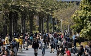 Students walk through campus between classes at Santa Monica College in Santa Monica