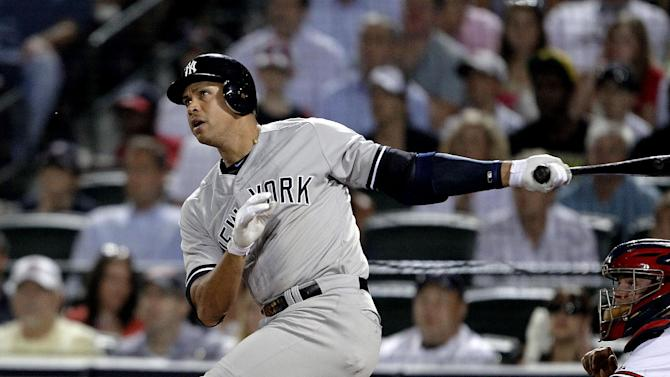 New York Yankees' Alex Rodriguez watches his grand slame in the eighth inning of a baseball game against the Atlanta Braves on Tuesday, June 12, 2012, in Atlanta. (AP Photo/David Goldman)