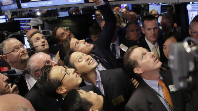 """Jack Ma, bottom center, founder of Alibaba, watches the company's stock pricing during its IPO at the New York Stock Exchange, Friday, Sept. 19, 2014 in New York. The stock is expected to start trading Friday under the ticker """"BABA."""" The IPO values Alibaba at $167.62 billion, larger than the current market value of Amazon, Cisco, and eBay. (AP Photo/Mark Lennihan)"""