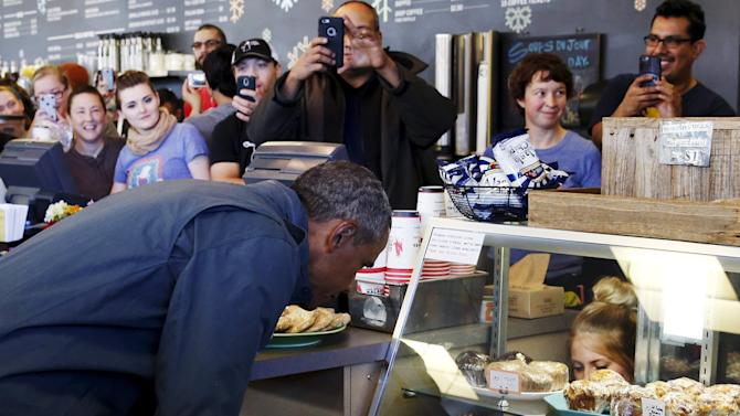Obama makes a pastry order at Snow City Cafe in Anchorage
