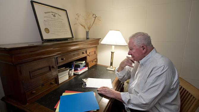 Sitting at a desk handed down from his grandfather, Dr. Paul Wilson, 80, a retired psychiatrist, recounts stories from his life which have become part of a memoir to share with his grandchildren about what his life was like, at his home in Bethesda, Md., Thursday, Oct. 4, 2012. Wilson expects his memoir to be roughly 60 pages when completed, plus some photographs and newspaper articles. He's considering having it self-published to produce a more polished final product. (AP Photo/J. Scott Applewhite)