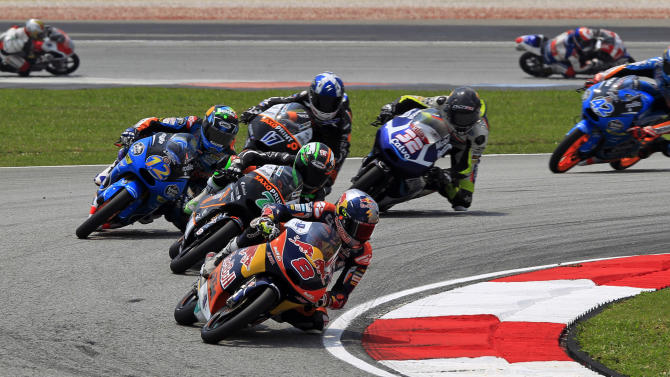 Moto3 rider Jack Miller, (8), of Australia leads the pack during the Malaysian Motorcycle Grand Prix in Sepang, Malaysia, Sunday, Oct. 26, 2014. (AP Photo/Lai Seng Sin)