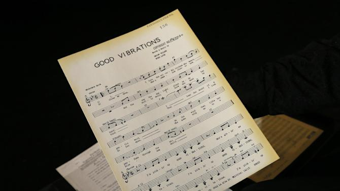 A musical manuscript of 'Good Vibrations' is displayed in London, Thursday, April 18, 2013. A large archive collection of The Beach Boys early compositions, contracts, publishing agreements, hand written songs and hand written musical manuscripts will be auctioned this month in one lot. The archive is being auctioned by closed bidding by The Fame Bureau in London, and bids are accepted up to May 15. (AP Photo/Kirsty Wigglesworth)