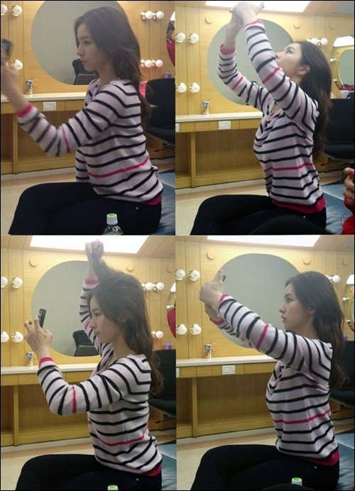 Shin Sekyung in the middle of taking self-photos