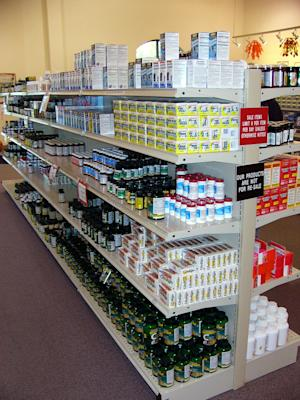 FILE- This Oct. 30, 2003, file photo shows drugs, vitamins and other Perrigo products on the shelves of the Perrigo Store in Allegan, Mich. U.S. drugmaker Perrigo agreed Monday, July 29, 2013, to buy Ireland's Elan for $8.6 billion in a deal that should allow the company to reduce its tax bill and boost its royalty stream. (AP Photo/James Prichard, File)