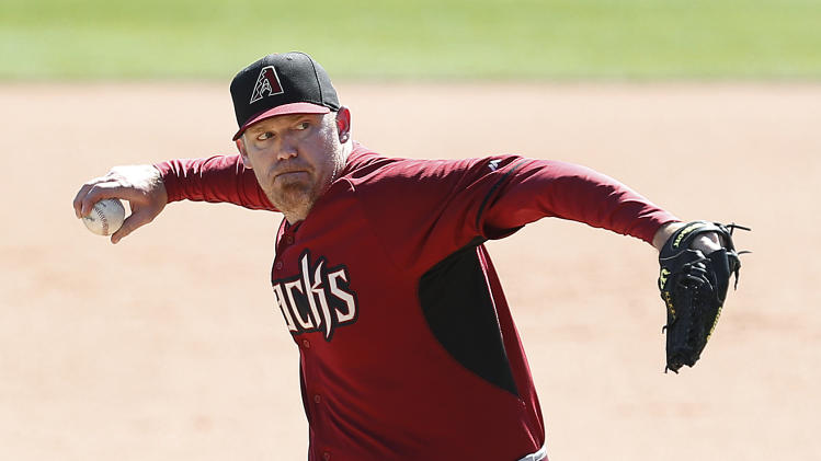 Arizona Diamondbacks pitcher J.J. Putz throws against the Chicago White Sox in the sixth inning during an exhibition baseball game in Glendale, Ariz., Saturday, March 8, 2014. (AP Photo/Paul Sancya)