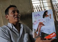This picture taken on November 28, 2012 shows Ko Oo Swe, editor of Myanmar&#39;s first sex education magazine, &quot;Hnyo&quot;, during an interview at his house in Yangon. &quot;Hnyo&quot; has since been banned after just one issue because it was deemed to have ventured beyond its remit as a &quot;fashion&quot; magazine, Ko Oo Swe told AFP