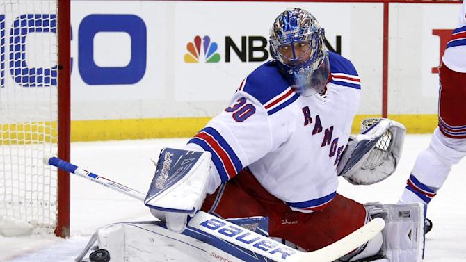 New York Rangers goalie Henrik Lundqvist (30) makes a save during the second period of an NHL hockey game against the Pittsburgh Penguins in Pittsburgh, Wednesday, Feb. 10, 2016. (AP Photo/Gene J. Puskar)